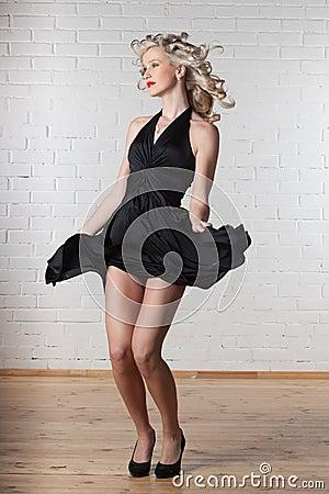 Young beautiful woman is dancing.