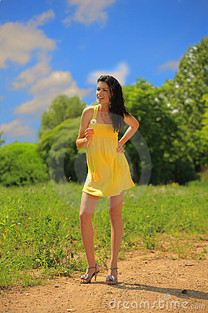 Young beautiful  woman with dandelion flower outdo