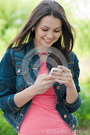 Young Beautiful woman & digital device outdoors