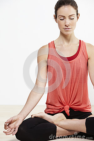Young beautiful woman doing yoga Stock Photo