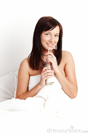 Young beautiful woman drinking milk