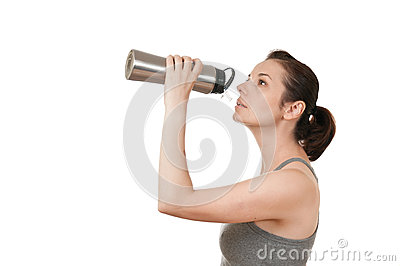 Young beautiful woman drinking water
