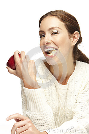 Young beautiful woman, eating an apple, smiling Stock Photo