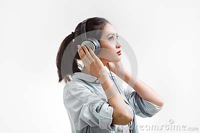 Young beautiful woman enjoy listening to music with big headphones isolated white background Stock Photo