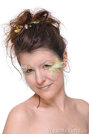 Young beautiful woman with feather make up