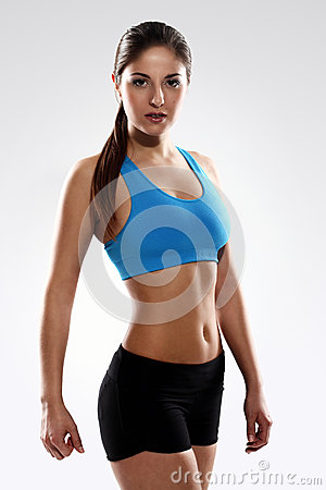 Young beautiful woman in fitness wear