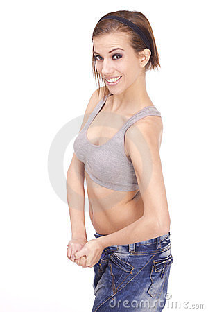 Young Beautiful woman flexing arm muscles