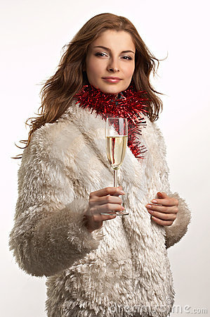 Young beautiful woman with glass of champagne