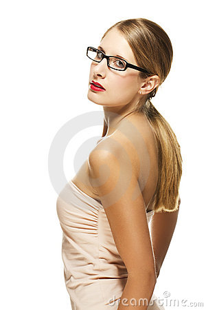 Young beautiful woman with glasses looking over he