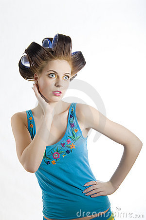 Young beautiful woman in hair curlers