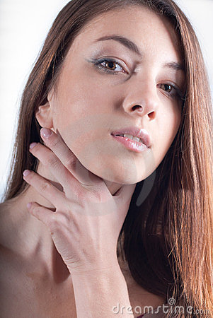 Young Beautiful Woman hand on neck headshot