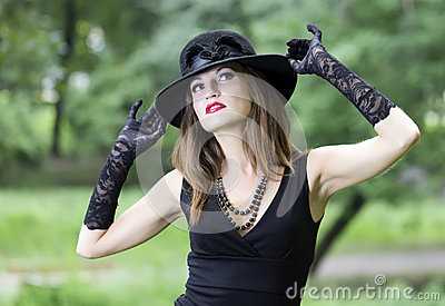 The young beautiful woman in a hat