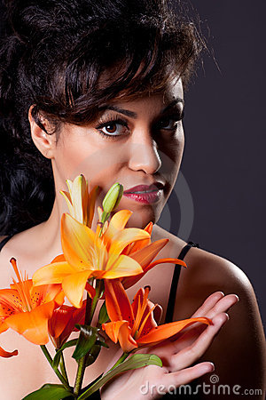 Young Beautiful Woman Holding Lily Flowers