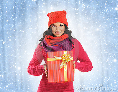 Young and beautiful woman holding a present