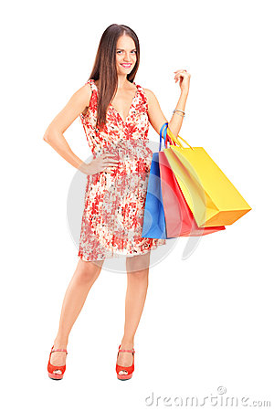 Young beautiful woman holding shopping bags