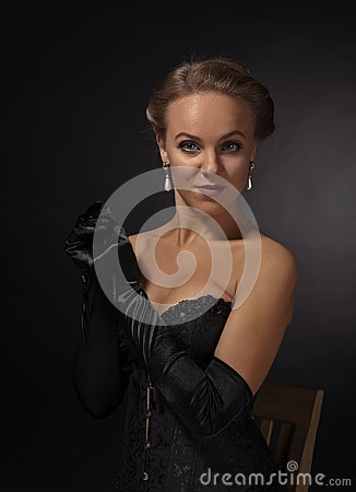 Free Young Beautiful Woman In Black Corset With Pearl Earrings Royalty Free Stock Photography - 83491137