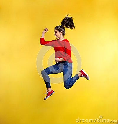 Free Young Beautiful Woman In Studio, Jumping. Stock Photos - 113030393