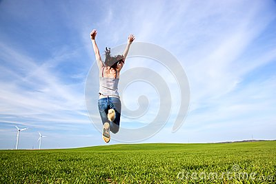 Young beautiful woman jumping for joy