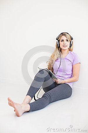 Free Young Beautiful Woman Listen Music With Headphones Stock Photography - 31023382