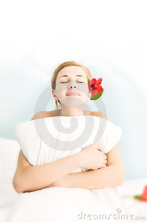 Young beautiful woman ob bed