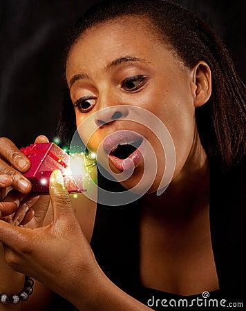 Woman opening a magic gift box