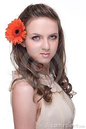Of young beautiful woman with  orange flower