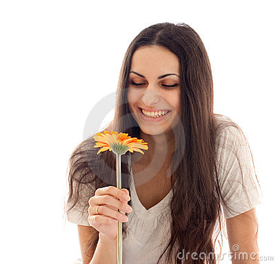 Young beautiful woman with orange flower  isolated