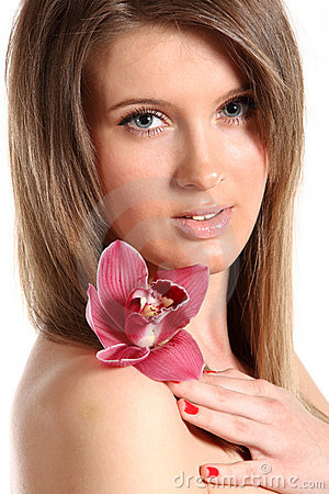 Young beautiful woman with orchid