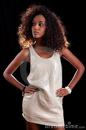 Young beautiful woman  over a black background
