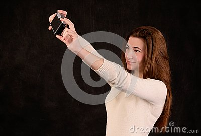 Young beautiful woman taking a picture of herself