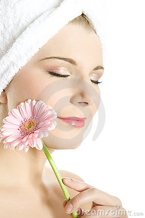 Young beautiful woman with pink gerber flower
