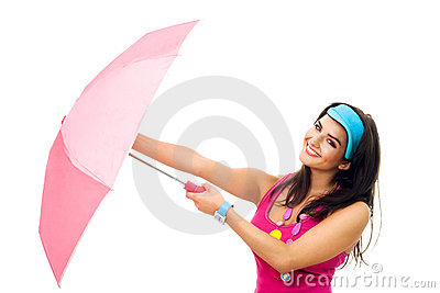 Young beautiful woman in pink open umbrella