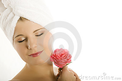Young beautiful woman with pink rose