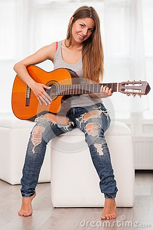 Free Young Beautiful Woman Playing Guitar Royalty Free Stock Photos - 51262088