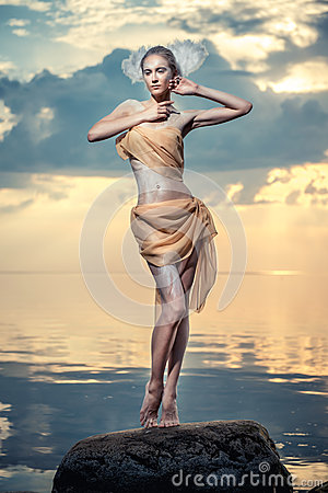 Free Young Beautiful Woman Posing On The Beach At Sunset Royalty Free Stock Images - 32237189