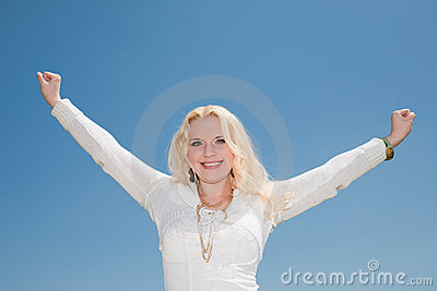Young beautiful woman with raised hands