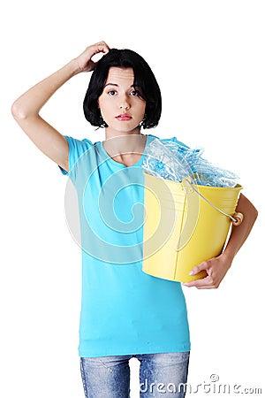 Young beautiful woman with recycling trash bin