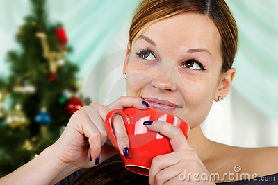 Young beautiful woman with a red cup