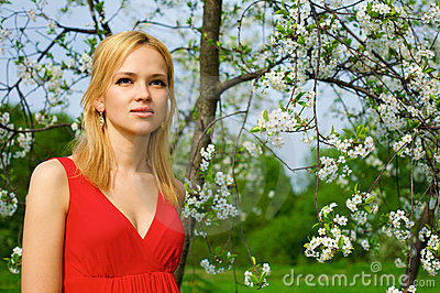 Young beautiful woman in a red dress