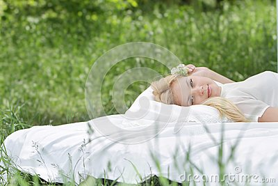 Young beautiful woman relaxing on nature
