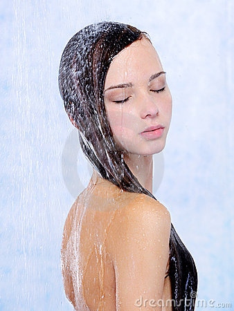 Young beautiful woman relaxing taking a shower