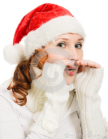 Young beautiful woman in a Santa hat whispers