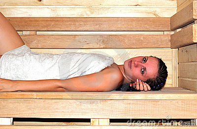 Young beautiful woman in sauna