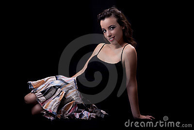 Young and beautiful woman  seated on floor
