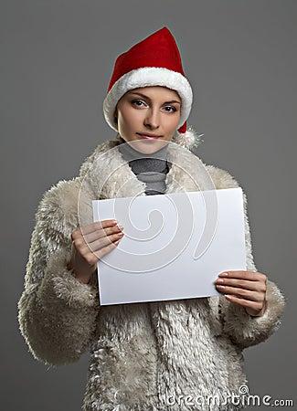 Young beautiful woman with sheet o