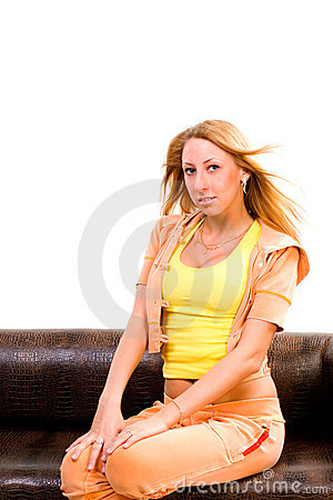 Young beautiful woman sit on sofa