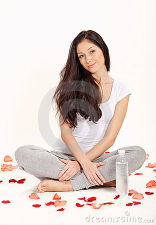 Young beautiful woman sitting in lotus pose