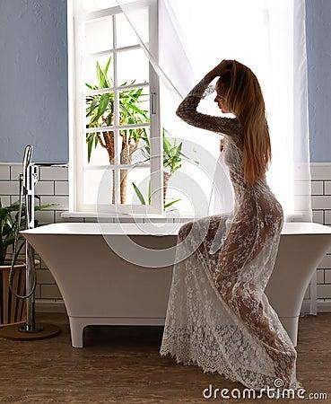 Free Young Beautiful Woman Sitting Near Bathtub Ready For Taking Bath Near Royalty Free Stock Photography - 107925117
