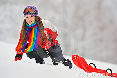 Young Beautiful Woman and sledge