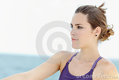 Young beautiful woman smiling and looking away